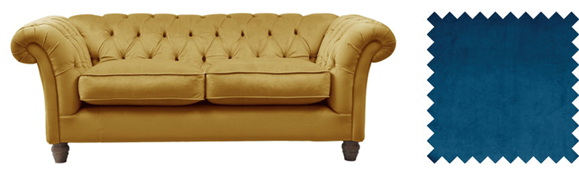 Gold velvet sofa with navy blue