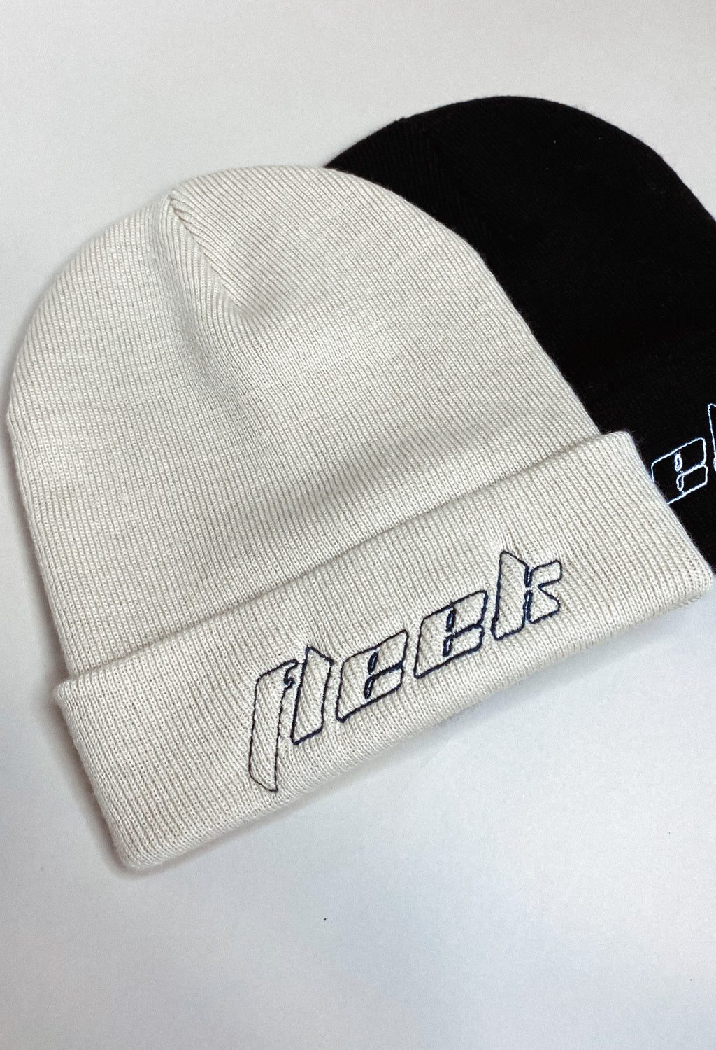 '' OUTLINE '' EMBROIDERED BEIGE BEANIE