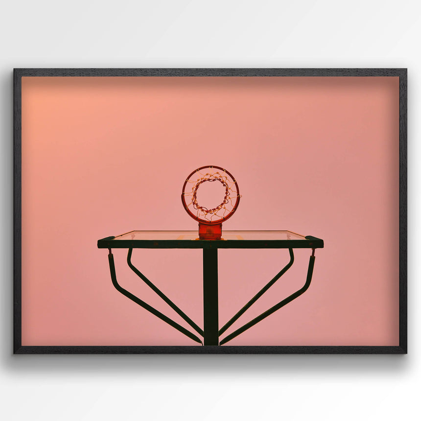 Pink sky with red and green basketball hoop