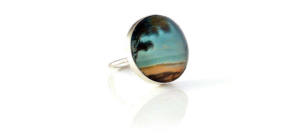 Silver statement ring with tropical beach scene