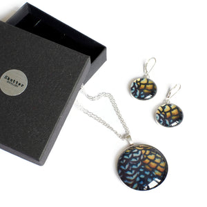 Reeves statement pendant and earrings