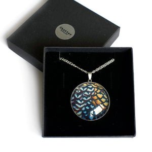 Gift boxed large silver pendant with copper pattern