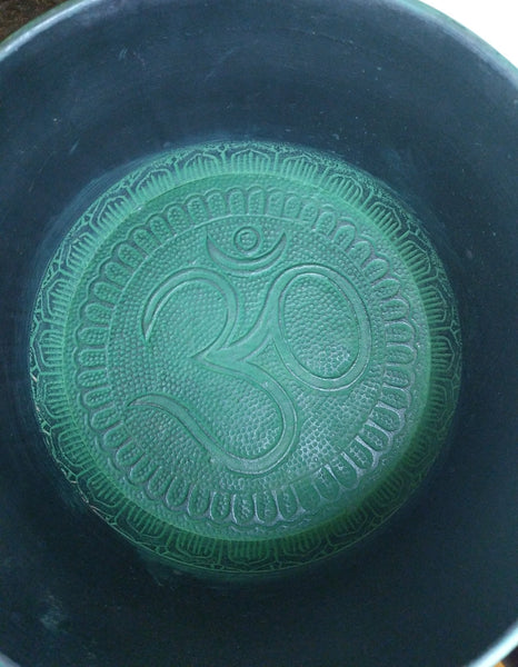 Tibetan singing bowl in Note D, 10 inches * 6 inches height from Aluminum with Om design inside and outside in Green Color.