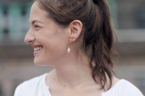 Smiling girl with an earring