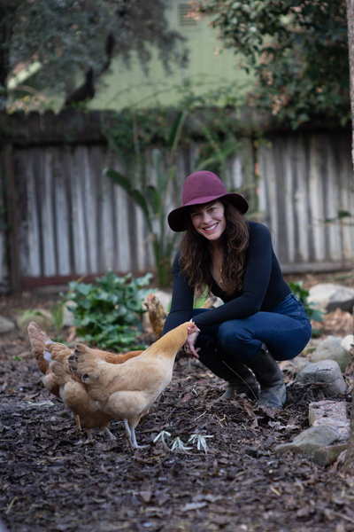 Emily Hirsch on the farm with chickens.