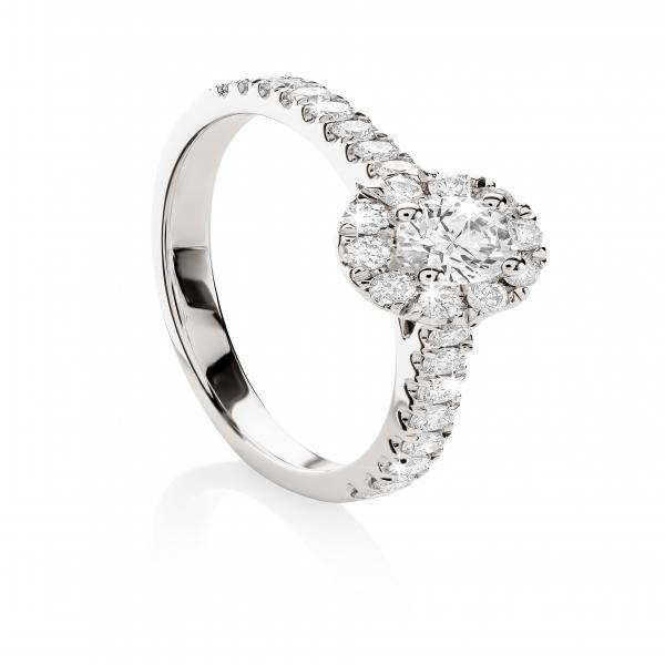 MP5591  18ct white gold 0.50ct TDW diamond halo ring with claw set shoulders.