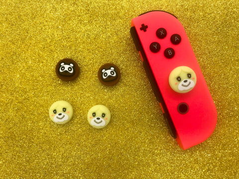 Isabelle and Tom Nook Thumb Grips - Animal Crossing Switch Button Caps