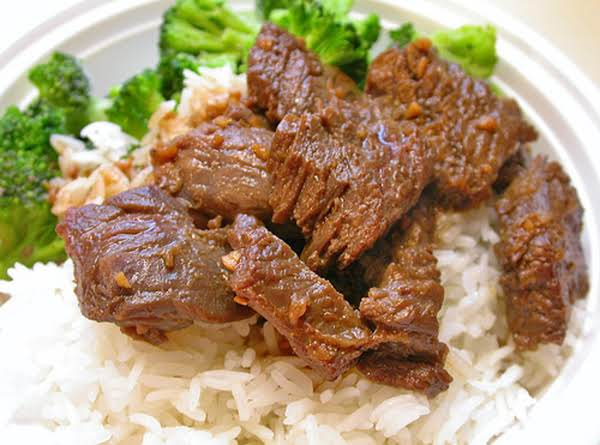 SAUCY BEEF OVER RICE