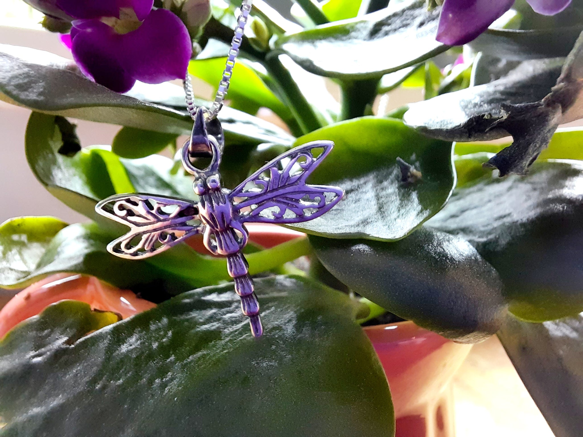 "Our sterling silver dragonfly pendant has pretty detail and the filigree design gives it a wonderful antique look. It is perched on a polished diamond cut sterling silver box chain (which through wear will dull).     Chain - 16-18"" with extender   Pendant size inc bale - 2.5cm x 2.5cm"