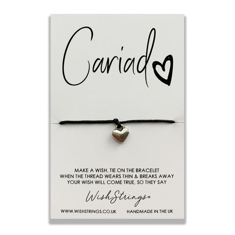 This is one of our favourites here at Adelic and we think it would be perfect to pop into a greeting card.  Handmade in the UK, a silver heart charm has been hand strung and knotted on 30cm of the finest waxed cotton cord. Presented on a luxury 350gsm display card.  Bracelet size - one size fits all, trim to fit Card size - 85mm x 55mm x 5mm.