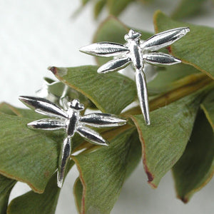 This pair of beautiful dragonfly stud earrings are crafted in sterling silver and have a polished finish. Fastened with sterling silver butterfly backs this nature inspired jewellery would make such a thoughtful gift for a friend or loved one.   Size - 10mm.