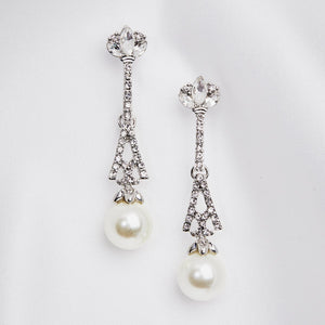 The Eiffel Tower in Paris is one of the most recognisable structures in the world. Add some ooh la la to your glamorous jewellery collection with these stunning Crystal & Pearl Eiffel Tower inspired drop earrings. Hypoallergenic & Nickel free .Cream Pearls.
