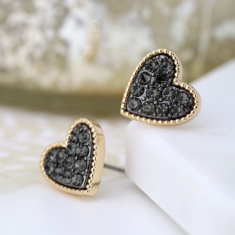 These black crystal earrings add just the right amount of sparkle to any look and we love them!  The outer edge of each heart is raised with a decorative dotted texture and they are plated in a layer of gold. The centre of both hearts are filled with black enamel and faceted black crystals creating a dramatic colour contrast and plenty of sparkle.   Size - 12mm. Nickel free