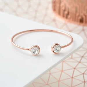 This is a real modern classic and we love the crystal stone ends. The rose gold plating adds warmth and is wearable with any outfit.   6.5cm width. To wear, gently place on the side of your wrist. Constant opening will cause the bangle to break. Hypoallergenic and Nickel free