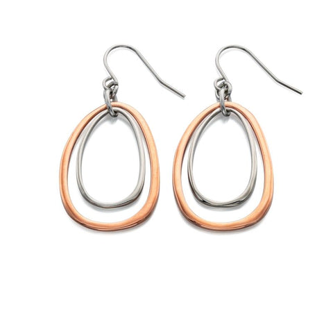 Made from rose gold and imitation rhodium plated metal, these organic shape drop earrings by Fiorelli have a wonderful modern feel. The silver oval gently sways inside the rose gold oval, which also moves. Light to wear you can be comfortable as they take you straight through to evening wear.     Size -  approx 4.2mm (from ear wire) x 1.9mm