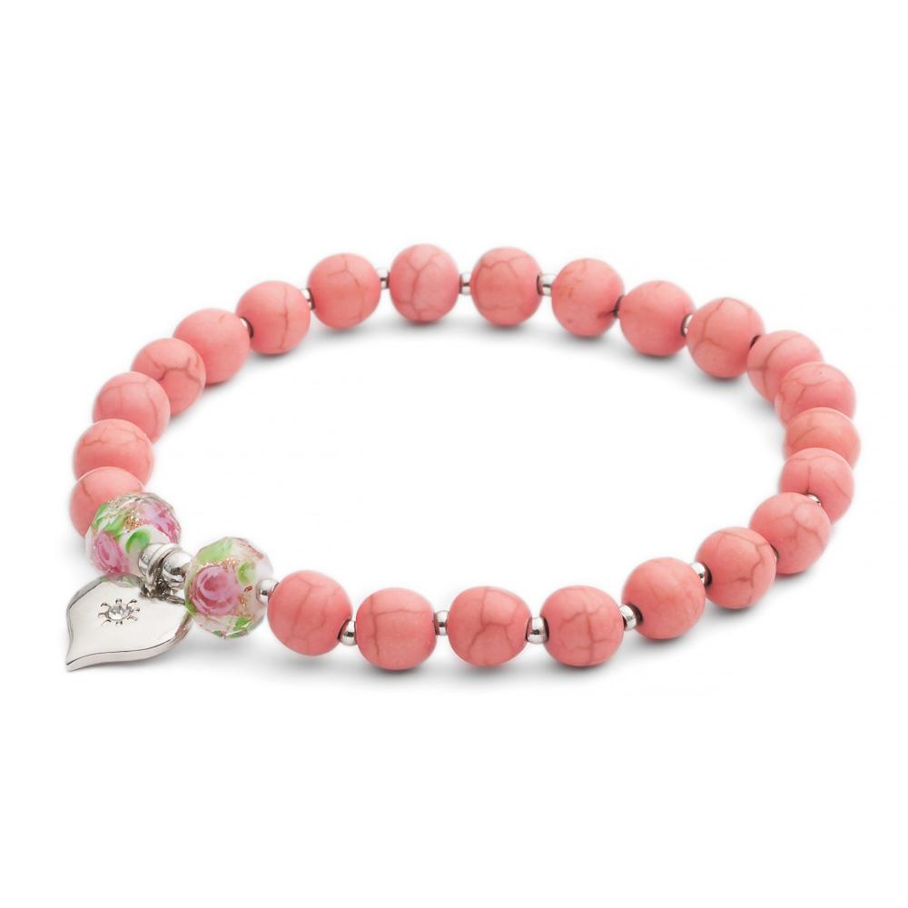 We love the natural marbling running through these semi-precious beads. They are separated by rhodium plated spacers. The bracelet is finished with two 1950's vintage rose glass beads and a signature heart. Handmade British Design. Hypoallergenic and Nickel free. Elasticated. One size.
