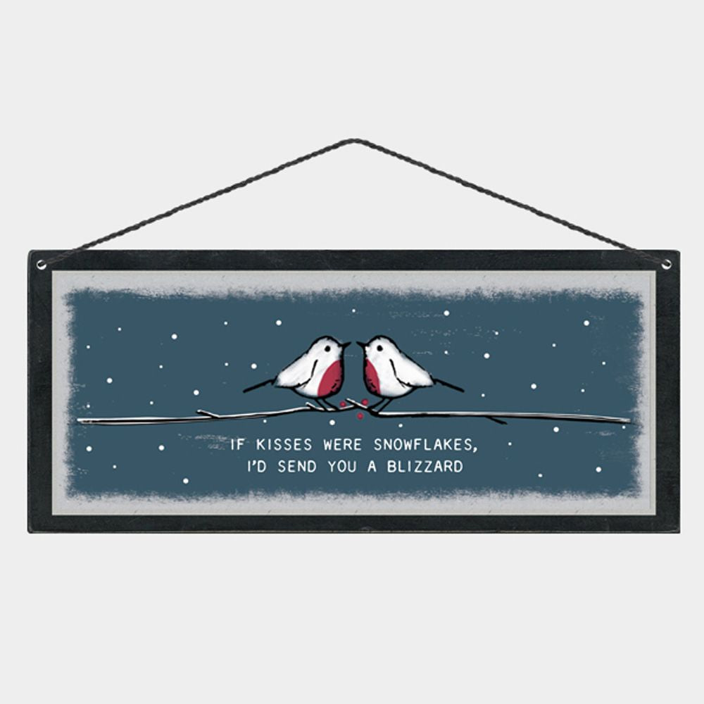 This East of India wooden Christmas plaque has the most beautiful illustrated image of two Robins in a Christmas scene with the words 'If kisses were snowflakes, I'd send you a blizzard'. The perfect gift for a loved one.      Size  - 20cm x 10cm with a black string hanger.