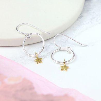 We love the mix of sterling silver and contrasting gold plated stars in these fine solid hoops. The stars move freely around the hoop creating a sense of movement and gentle swing. They would make a lovely gift for someone special.    Size - approx hoop size 12mm, star size 5mm.