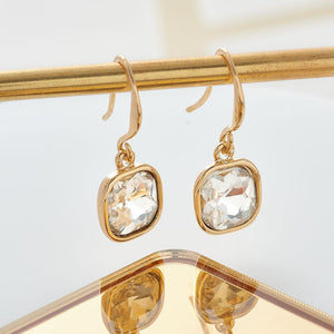 Both contemporary and classic in design, these stunning square drop earrings with a sparkling crystal are the perfect addition to any fashion lovers wardrobe.   Hypoallergenic and Nickel free. 2.5cm length, 1cm width.