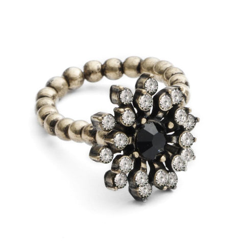 Did you know it is in the 17th century that retail jewellers emerge, distinct from the craftsman jeweller of the past? Have a part of history with our gorgeous Baroque inspired stretch ring.  A Starburst Flower design in Crystal with a Black Stone centre.   A handmade British design in brass plating. Adjustable fit. 15mm inside diameter.