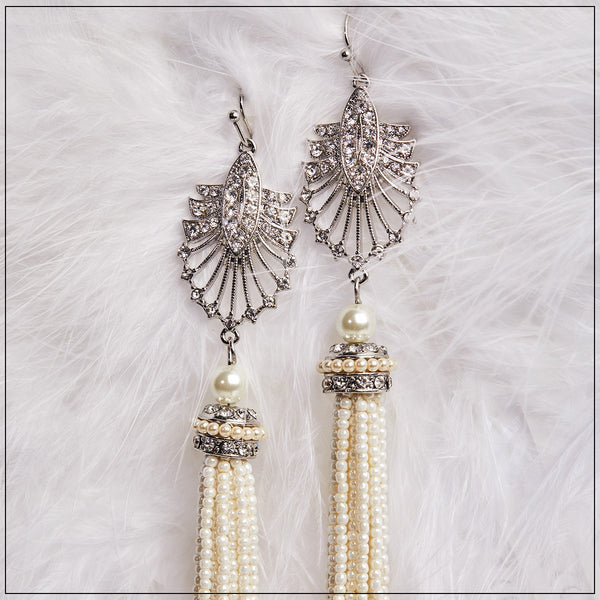 A unique and exquisite pair of earrings inspired by 1920's Art Deco design and The Great Gatsby. This is a piece to keep forever and wear over and over again.   Hypoallergenic and Nickel free.  Length - 11cm.  Colour - Cream Plating - Brass