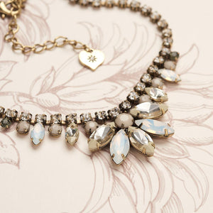 This white opal and diamante necklace is a classic blend of modern design with vintage styling. Inspired by the 1950's it has been hand painted and would make the perfect elegant accessory.    Hypoallergenic and Nickel free. 38cm length with 5.5cm adjuster.