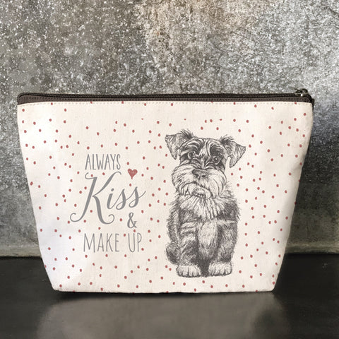 "A wonderful beige canvas toiletry / cosmetic bag with a beautiful image of a terrier on the front and back, with the phrase ""Always kiss and make up"". Red polka dots feature all over the main body of the bag. Lined with waxed black cotton your items will be kept secure with a black zip and metal pull.   Size - 25 x 15.5 x 0.7cm."