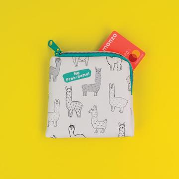 Need a snazzy and fun purse? No prob-llama! This perfectly sized purse is ideal as a change purse, sewing case and just about anything in-between! Size - 11.5 x 11 x 1.5cm.