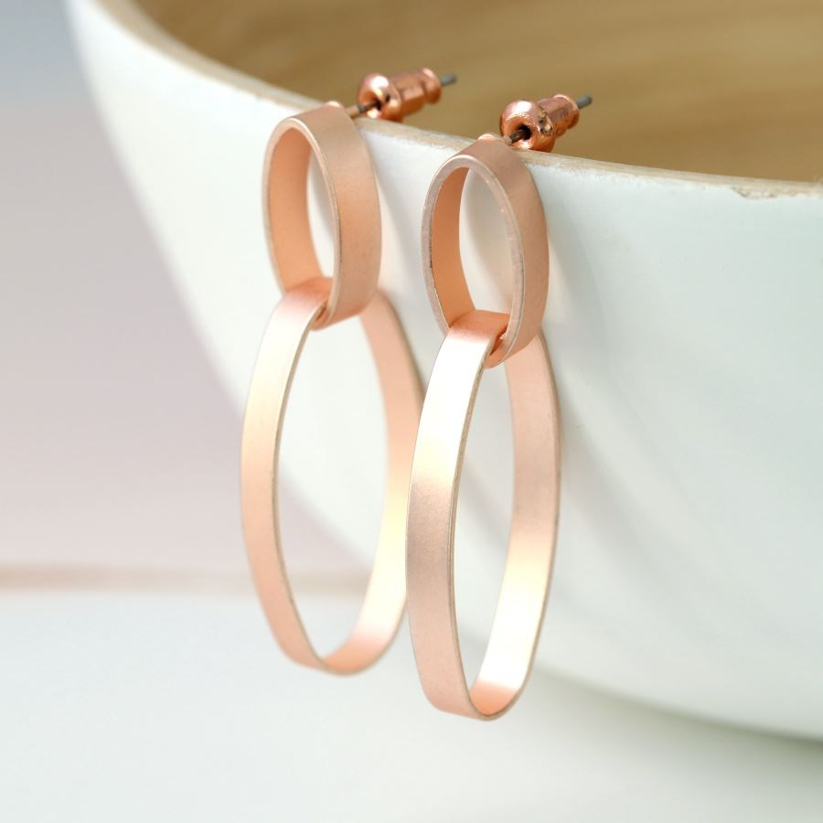These contemporary rose gold double hoop earrings have a pretty matt finish, bringing a blush pink tone to this design. A large oval hoop is linked through each smaller hoop and hangs below, creating movement and length. We love the creative use of these simple shapes!     Size - large hoop 30mm x 15mm         - small hoop 15mm x 7mm