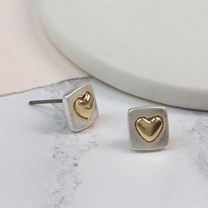 A chic worn finish has been given to these pretty silver plated squares to reduce the shine and create a contemporary look. A golden heart shape is set into the centre of each square with a smooth raised surface and a polished finish.  Size - Approx 8mm