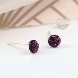 Do you like to add colour and sparkle to your look? Then these sterling silver studs inset with little Amethyst crystals are the perfect choice. They have been crafted with a round dome surface and each crystal is faceted to catch the light when worn.   Size - approx. 5mm