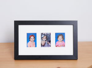 family photos in a 3 window black picture frame