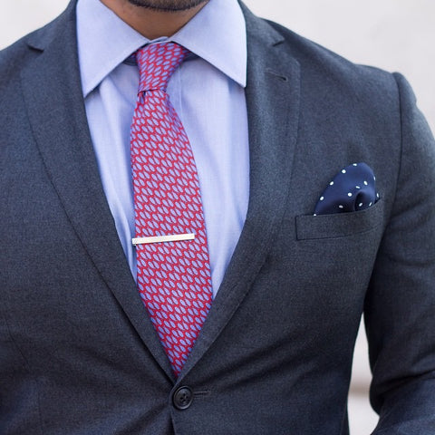 Printed Silk Red and Blue Tie against a Blue Shirt