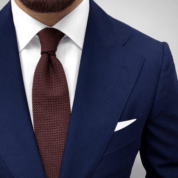 Brown Grenadine Tie With A Navy Suit