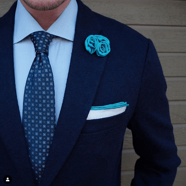 Navy Blue Suit With A Blue Tie