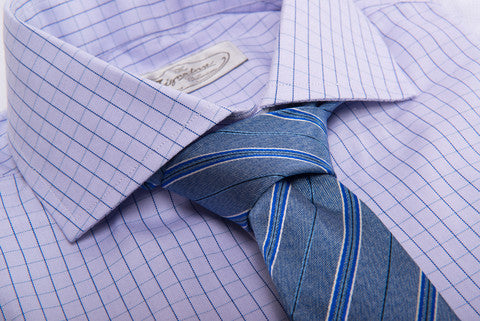 Blue Repp Striped Tie against a checkered shirt