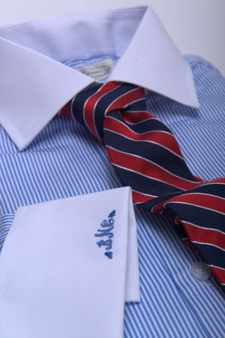 University Striped Tie against Narrow Striped Shirt