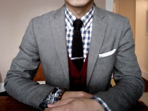 burgundy cardigan with a black knitted tie