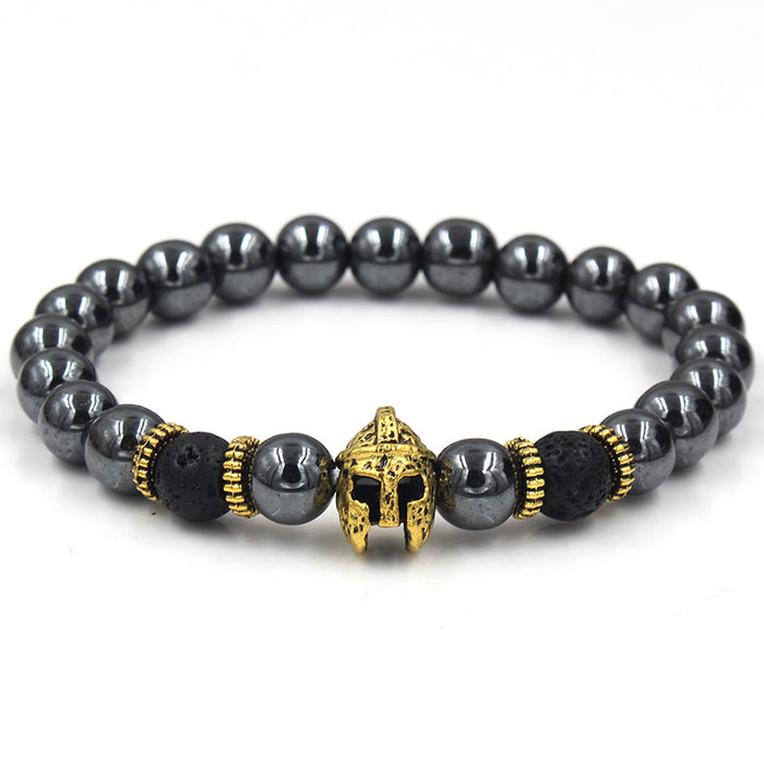 Black beaded bracelet with gold helmet