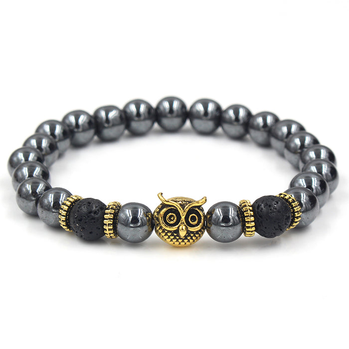 Black beaded bracelet with gold owl's head