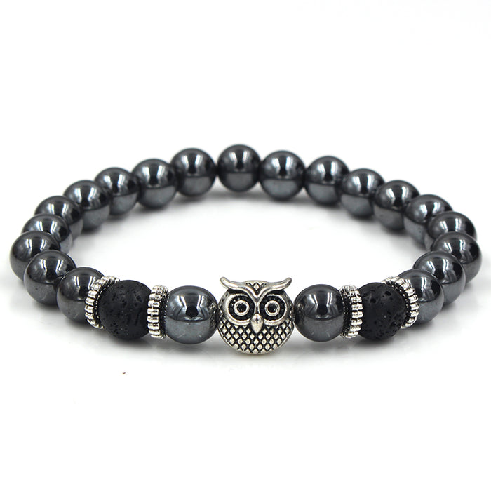 Black beaded bracelet with silver owl's head