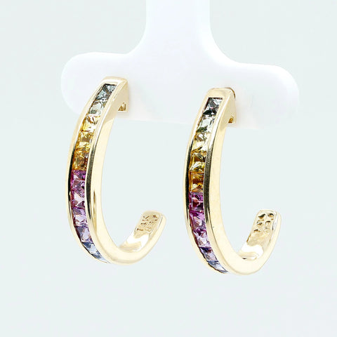 Half hoop earrings set with natural princess cut sapphires