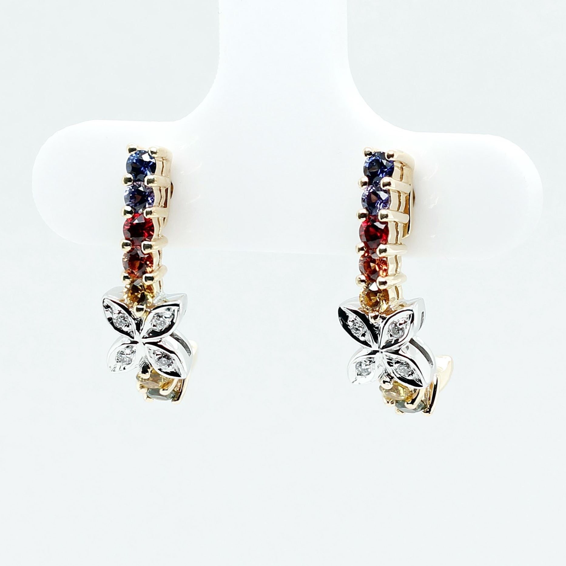 Four petals earrings with top-quality round brilliant cut natural sapphires, rubies and diamonds