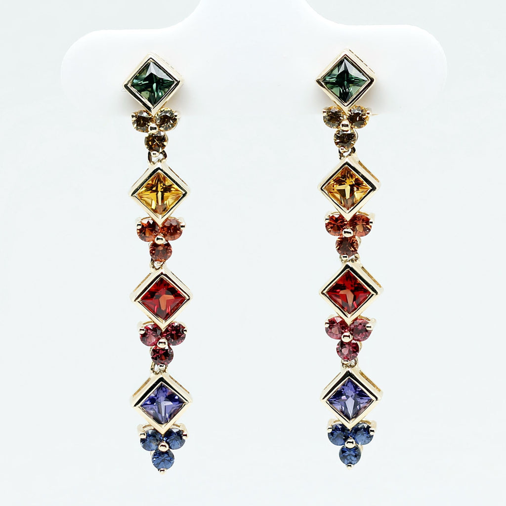 Customized/Personalized 14K yellow gold articulated dangling earrings set with top-quality, highly saturated channel set princess cut natural rubies and sapphires yves lemay jewelry https://youtu.be/EAZv7lXzHBY