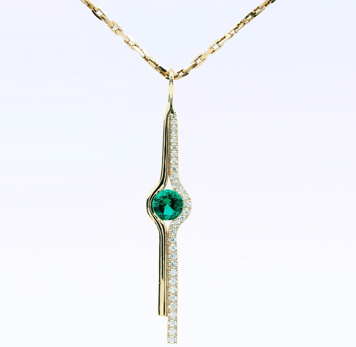 Gold and emerald tandem pendant