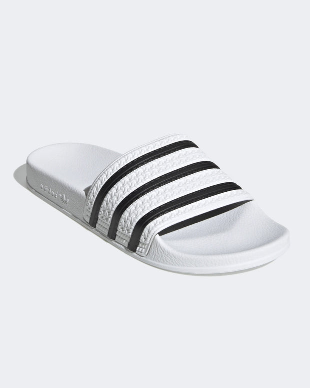 The most popular summer footwear in New Zealand. The simple and comfortable Adilette slide from Adidas Originals is a classic. Introduced in 1972 and staying popular for every situation till this day. Pop them on lounging around the house, or wear them out and about on a classic beach trip. Any time, any where - slide your foot into adidas history.