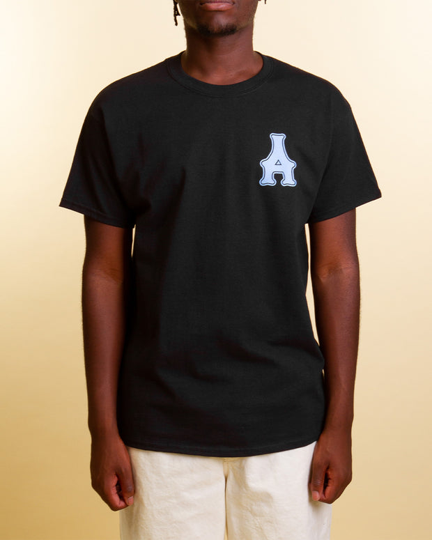 Arcade takes a popping approach to branding with the Dreams Tee in black. Constructed from 100% cotton, this black t-shirt features the Arcade logo printed in blue on the front, paired with a decorative yellow design printed on the back. Ready to be worn at the comfort of your own home, or cruising the city - this tee will have you looking good in no time.