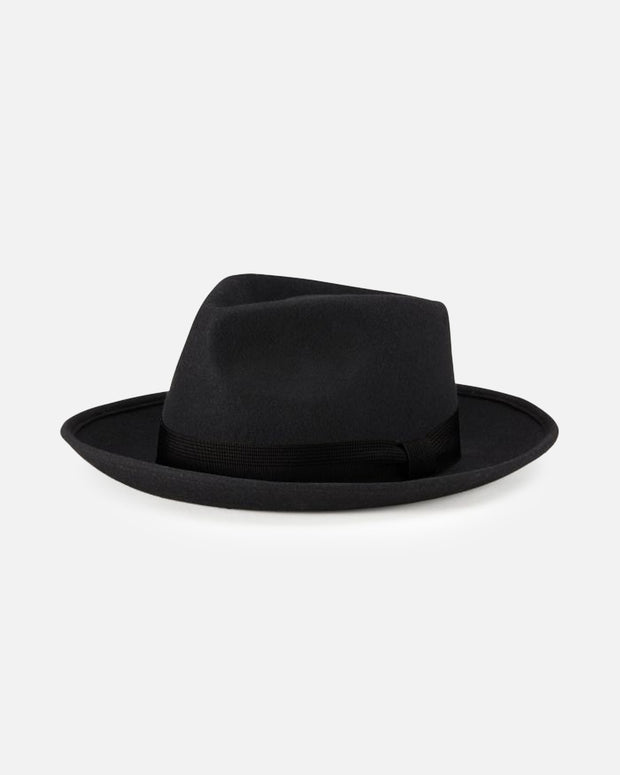 The Strummer Fedora Hat in Black a special release from Brixton. Full black fedora style hat with a medium sized brim, constructed from wool felt and featuring a black grosgrain band around the head. Finishing with a premium custom lining of Joe Strummers setlist in the inside.