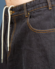 The Butter Goods Santosuosso Denim Pants in Washed black, also known as the Philly Denim are a baggy jean with a custom fit. Made from 100% cotton, washed black denim, these jeans are fitted with a custom top button and fly closure. Boasting plenty of pockets for essential storage, these pants are fitted with belt loops on the waist band and an internal drawstring. Signed off with a custom leather patch and woven brand label on the back.