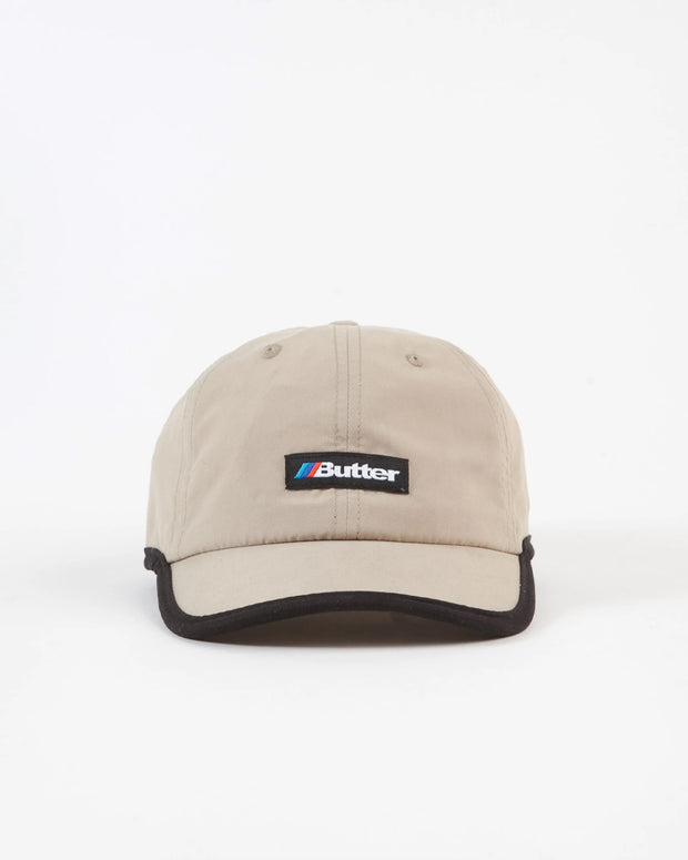 The perfect way to complete your weekend attire, the Auto 6 Panel Cap from Butter Goods comes in a khaki colourway. Constructed from a polyester upper, this 6-panel cap features a woven label at the front with embroidered eyelets and clean contrasting trim. Signed off with a comfortable velcro adjustable strap.